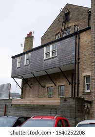 Cantilevered upper extension with windows and fire escape on a building in Huddersfield Yorkshire England 24/10/2019 by Roy Hinchliffe