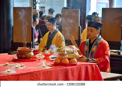 CANTON, CHINA – CIRCA FEBRUARY 2019: The taoist priests hold a requiem for the dead. Chinese New Year memorial service hold in the taoist temple in Guangzhou.