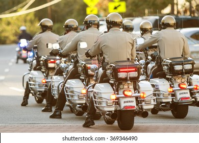 CANTON, GA - OCTOBER 17:  A group of local motorcycle police officers in the Sheriff's Department ride through town in unison as part of the Cherokee Zombie Fest on October 17, 2015 in Canton, GA.