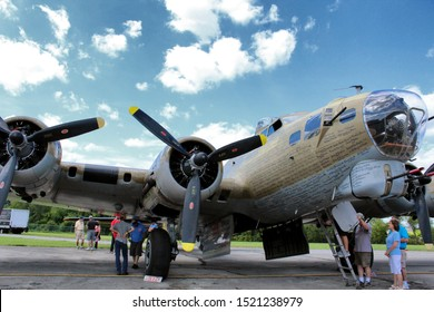 "Canton, Ohio / USA - 08/11/2019: Front-view (exterior) of Collings Foundation's B-17 Flying Fortress ""Nine O Nine"".  At the MAPS Air Museum in North Canton, Ohio, part of the ""Wings of Freedom"" tour."