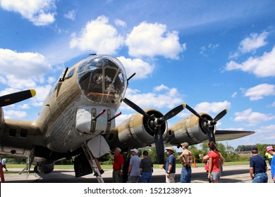 """Canton, Ohio / USA - 08/11/2019: Front-view (exterior) of Collings Foundation's B-17 Flying Fortress """"Nine O Nine"""".  At the MAPS Air Museum in North Canton, Ohio, part of the """"Wings of Freedom"""" tour."""
