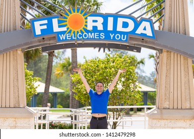 Cantonment, USA - April 24, 2018: Florida welcome center at border with Alabama and visitor center and young happy man by sign