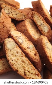 Cantuccini alla mandorla, italian cookies on white background