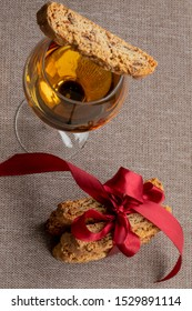 Cantuccini. Italian Cantucci Biscuit And A Glass Of Wine. Vin Santo. shining wine