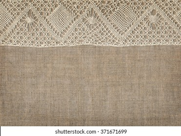 Canvas background with white lace in corners