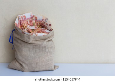 Canvas bag with five thousand banknotes