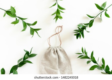 Canvas bag with frame made of ruscus branches on white background