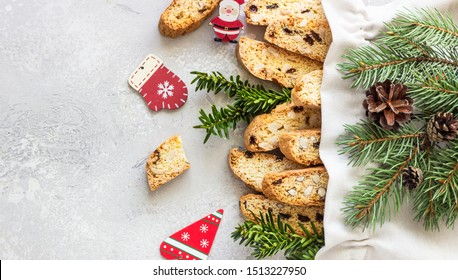 Canvas bag with traditional Italian cookies biscotti or cantuccini with hazelnuts. Christmas or New year décor.  Top view.