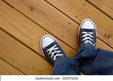 Canvas basket ball shoes on clean wood deck
