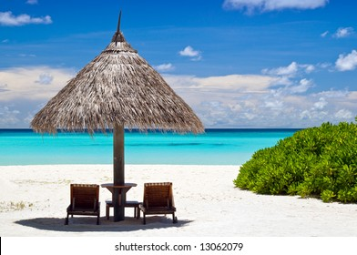 canvas chairs with parasol on a beautiful beach