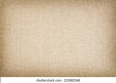 Canvas / cotton woven fabric background with flecks of varying colors of beige and brown.