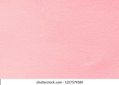 Canvas fabric texture background in pink-beige color.