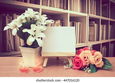 Canvas Frame And Flower With Perspective Bookshelf Background