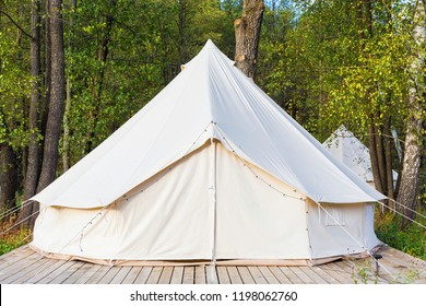 Canvas glamping bell tent at forest