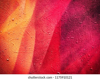 Canvas with hand drawn abstract hot pink, scarlet and coral color pastel or oil paint smears, lines, spots and geometric figures.