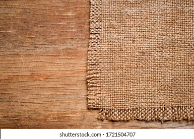 A canvas napkin lying on a wooden surface. Background for fall and natural objects.