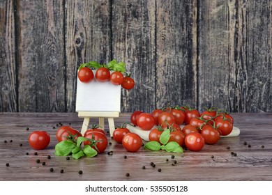 The canvas on the easel and scattered cherry tomatoes in rutical style.