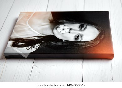 Canvas print with gallery wrapping. Photography of woman stretched on stretcher bar, lateral side