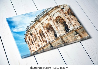 Canvas print. Photo with gallery wrap method of canvas stretching on stretcher bar. Photography with image of the ancient Roman amphitheatre in Nimes city, France
