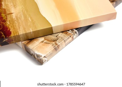 Canvas prints isolated on white background. Wrapped canvases, edge, corner, closeup. Detail of stretched photography with gallery wrapping. Photo printed on canvas - Shutterstock ID 1785594647