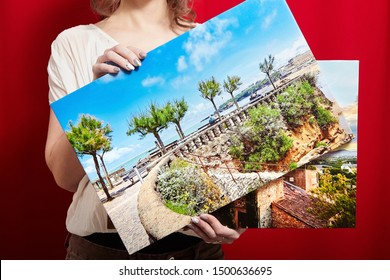 Canvas prints. A woman holding two photographs with gallery wrap on red background. Landscape photo printed on glossy synthetic canvas and stretched on wooden stretcher bar
