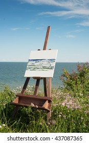 canvas rests on a easel , landscape