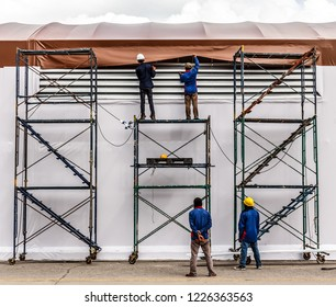 Canvas roof installation technician install tensile fabric structure