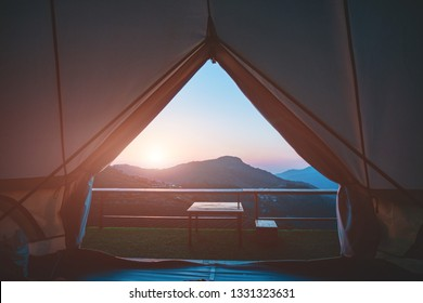 Canvas tent look from inside to see natural view in the morning.Camping with rural scene morning landscape.