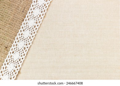 Canvas Texture With Burlap And White Lace As Frame Design For Background