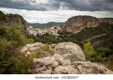 canyon with boulders and a view of Chulilla town, province of Valencia, Valencian Community, Spain