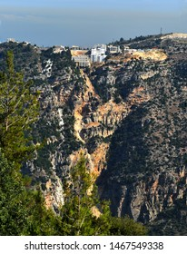 Canyon of River Nahr Ibrahim, Lebanon landscape with an house strangely built at the edge of a dangerous cliff with signs of erosion