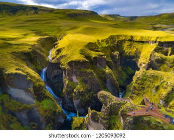 Fjaðrárgljúfur is a canyon in south east Iceland which is up to 100 m deep and about 2 kilometers long, with the Fjaðrá river flowing through it .The canyon has steep walls and winding wate