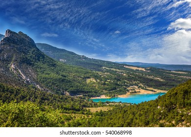 Canyon of Verdon, Provence, May. Magnificent lake with emerald water among wooded hills