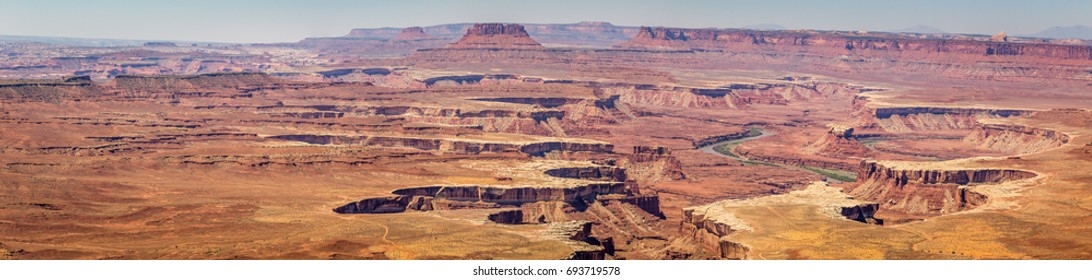 Canyonlands National Park is in Utah near Moab. It preserves a colorful landscape eroded into canyons, mesas, and buttes by the Colorado River, the Green River, and their respective tributaries.