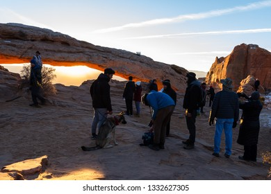 Canyonlands NP, Utah - December 20: Photographers and tourists lined up for sunrise views at Mesa Arch. December 20 2018, Canyonlands NP, Utah