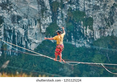 Canyons, RS / Brazil - December 2018 - Unidentified man crossing a slack line over the canyons, mountains, extreme sports, adrenaline, balance, isolated athlete, nature sports, rope