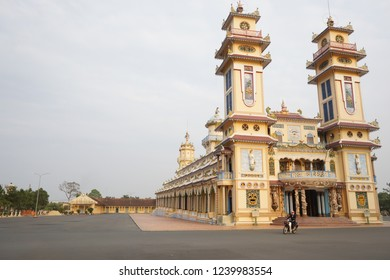 Cao Dai Temple in Tay Ninh City. This main temple and other buildings open freely for tourists & others to worship the harmony of universe & earth. Cao Dai people wear white ao dai and black trousers.