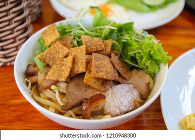 Cao lau is a regional Vietnamese dish made with noodles, pork, and local greens,