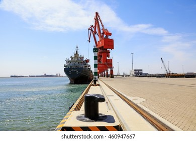 Caofeidian - April 17: cargo ships and tower crane on the freight terminal, on April 17, 2016, caofeidian, hebei province, China