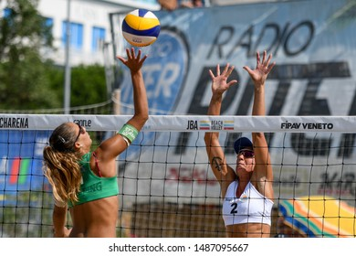 Caorle (VE), Italy, August 25 2019 Schiacciata di Michela Lantignotti e muro di Jessica Allegretti during Semifinals Championship Absolute 2019 - Men And Women Beach Volley