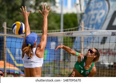 Caorle (VE), Italy, August 25 2019 schiacciata di Michela Lantignotti muro di Giulia Toti during Semifinals Championship Absolute 2019 - Men And Women Beach Volley