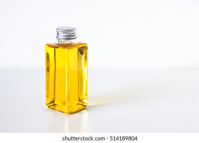 Cap and bottle mock up with moisturizing and nutritious body care cosmetic.Natural Moroccan Argan oil for skin and hair