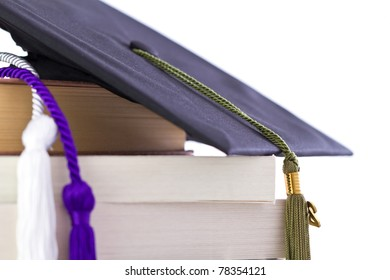 cap and cords on books, achievement and education symbols