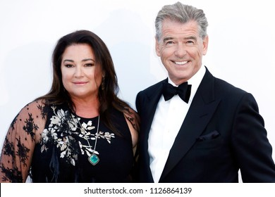 CAP D'ANTIBES, FRANCE - MAY 17:  Pierce Brosnan and Keely Shaye Smith arrive at the amfAR Gala Cannes 2018 at Hotel du Cap-Eden-Roc on May 17, 2018 in Cap d'Antibes, France.