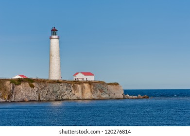 Cap des rosiers lighthouse during a cloudless day, Quebec, Canada