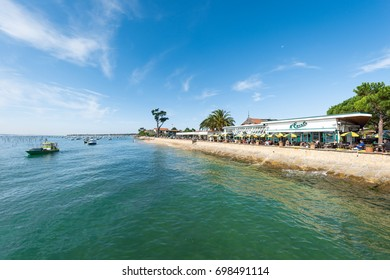 CAP FERRET, FRANCE—AUGUST 13, 2017: restaurants and cafes at the seaside of the Cap Ferret, on the Arcachon Bay, in front of the dune of Pyla.