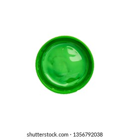 Cap from a green gouache jar paints - top view, isolated on white background with copy space. Cans of different colors gouache paints.