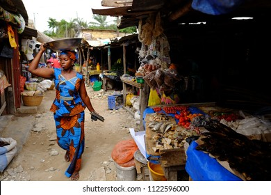 Cap Skirring, Senegal - June 19 2018: Woman in a traditional market in Senegal.