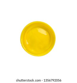 Cap from a yellow gouache jar paints - top view, isolated on white background with copy space. Cans of different colors gouache paints.