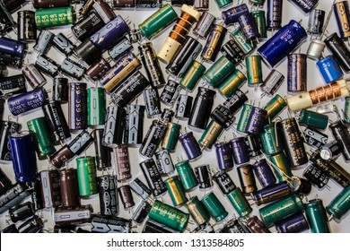 Capacitors of different types from laptops and other devices. Background saver for system administrators. Ukraine - Kyiv - February 15, 2019.